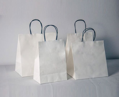 What kind of material is white kraft paper made of?